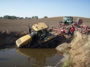 cat tractor in a mudhole