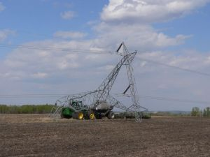Tractor and planter tear down power line