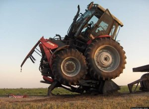 tractor runs over front end loader