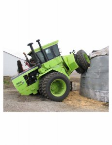steiger tractor backs over grain bin
