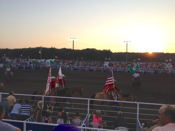 "The rodeo queen and the two ""pick up"" men starting the grand entry"